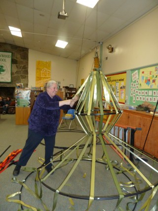 "Greenwood faculty member Annie Quest works on Yellow Barn's ""Mad King"" cages"