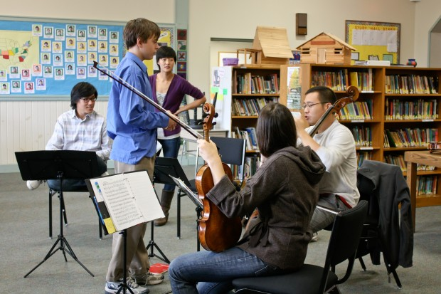 A Greenwood student works with the Parker Quartet